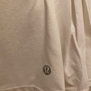 Lululemon white tennis skirt size 4 NEVER WORN!!